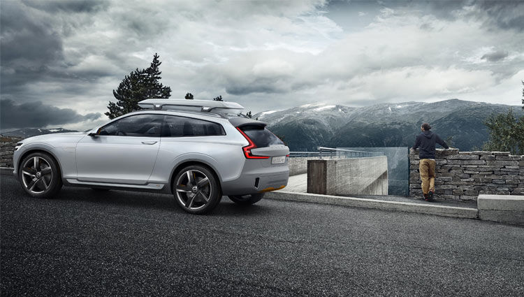 VOLVO XC50, THE SWEDISH COUPE SUV -Man Stands in Cloudy Weather Next to Volvo XC50