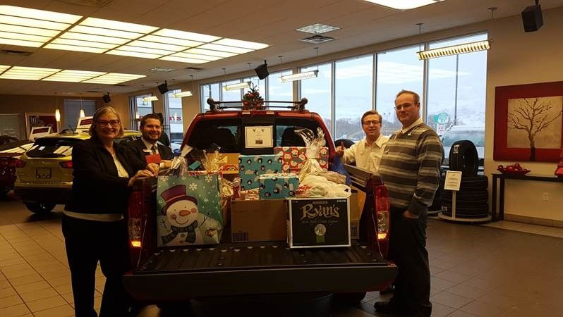 Vernon Nissan Annual Christmas Gifts for a Local Family in Need