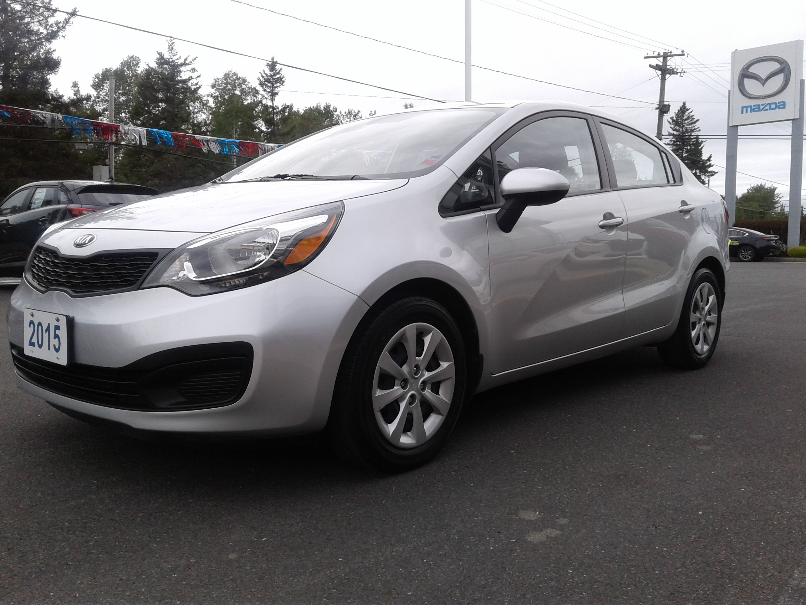 bayside mazda pre owned 2015 kia rio lx for sale. Black Bedroom Furniture Sets. Home Design Ideas