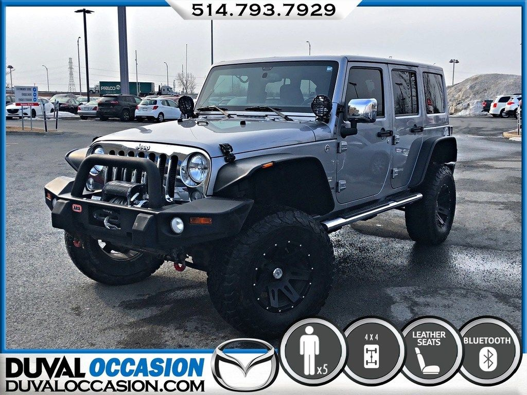 Duval Mazda Pre Owned 2014 Jeep Wrangler Unlimited Sahara Cuir Navigation Toit Souple Canvas For Sale
