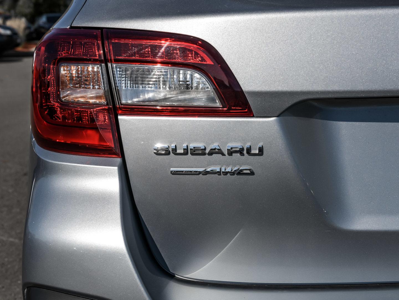 Subaru Legacy: Rear gate (Outback)