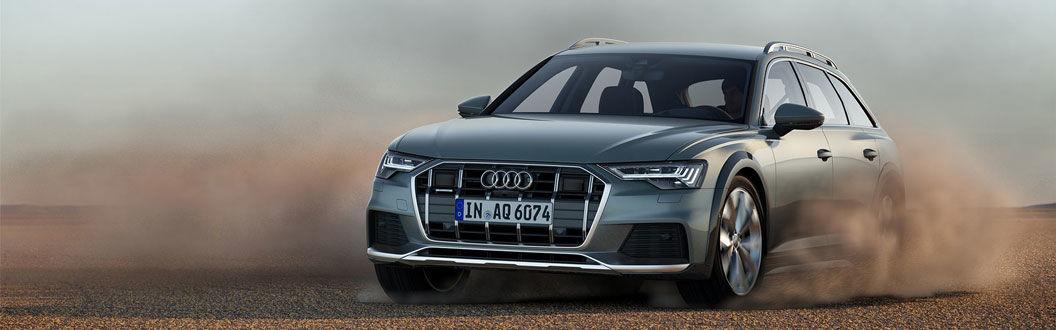 The 2020 Audi A6 allroad speeding through sand