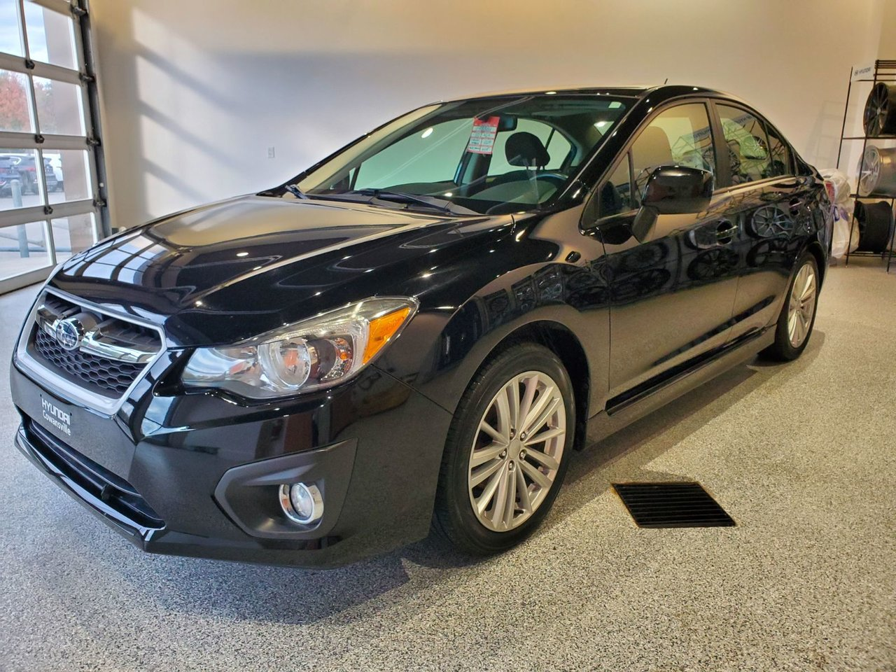 2014 Subaru  Impreza Sedan AWD - SIÈGES CHAUFFANTS - TOIT OUVRANT - MAGS
