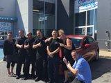 L'équipe de Chambly Mazda félicite M. Li pour sa nouvelle Mazda 3, Chambly Mazda
