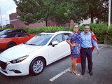 Superwoman Isabelle with her new Mazda 3